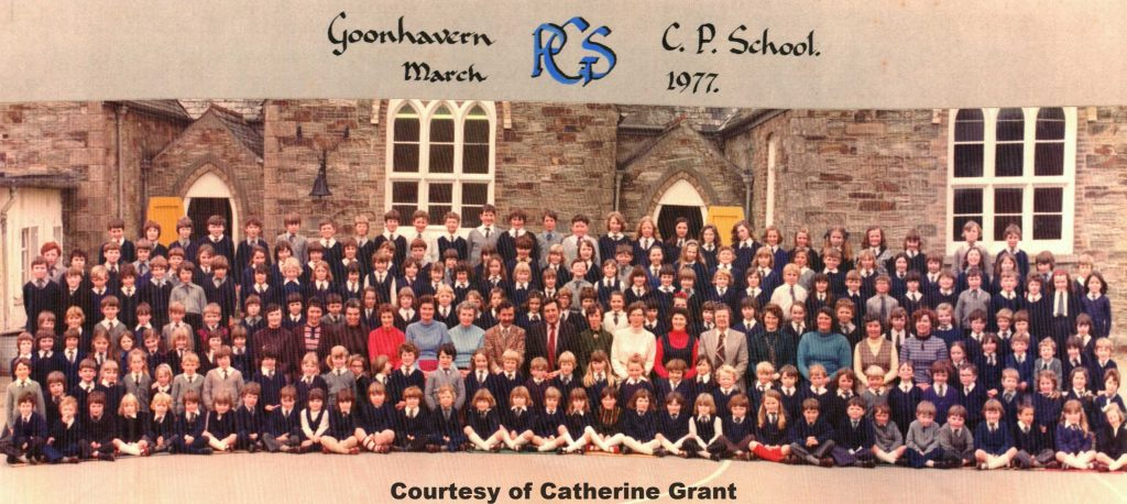 This photo was apparently taken in celebration of the School's 100th Centenary, showing Mr Tom Delbridge Headmaster, his Staff and pupils.