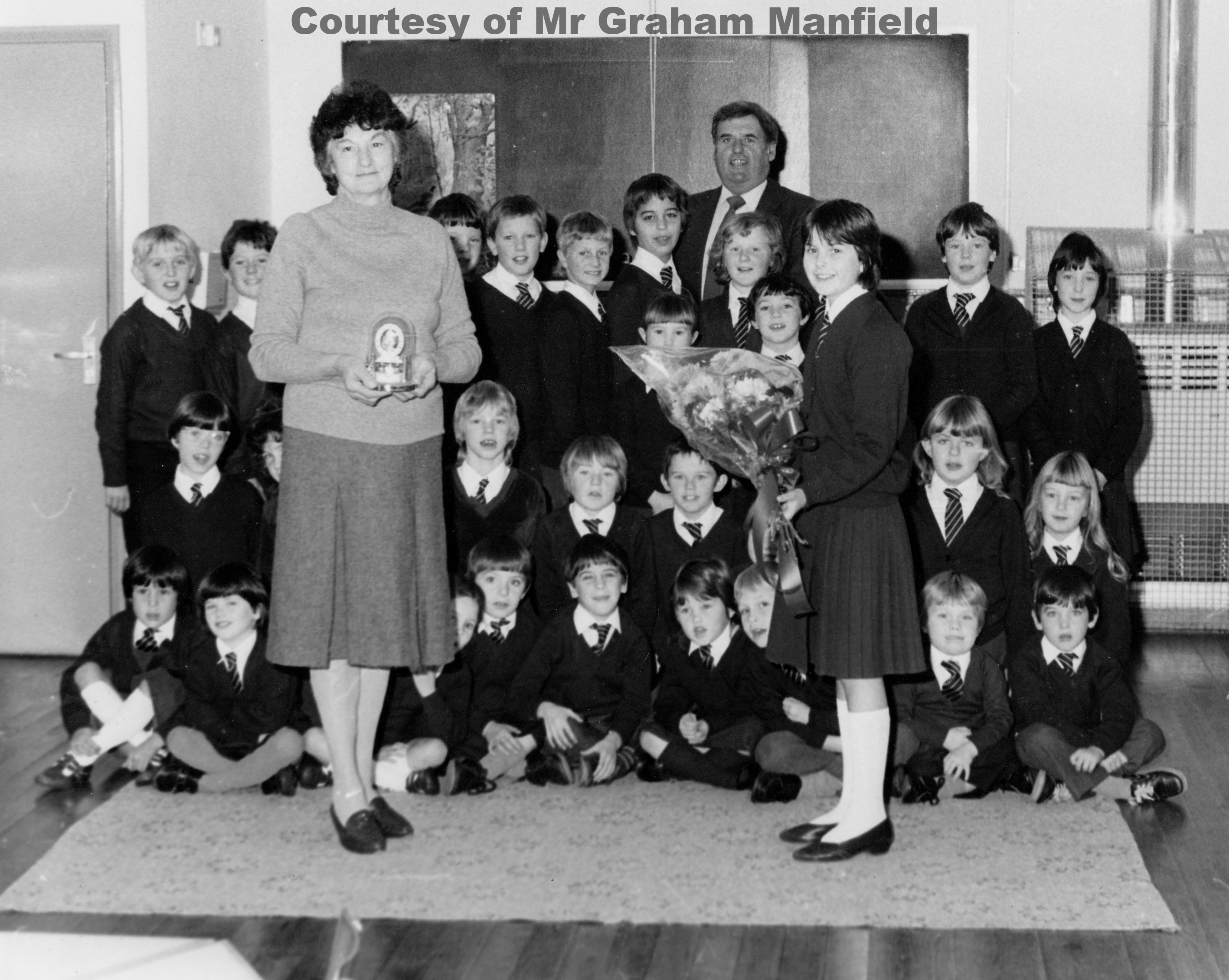 Mrs Margaret Manfield Caretaker at Goonhavern School retires in Nov 1983 after 14 years.